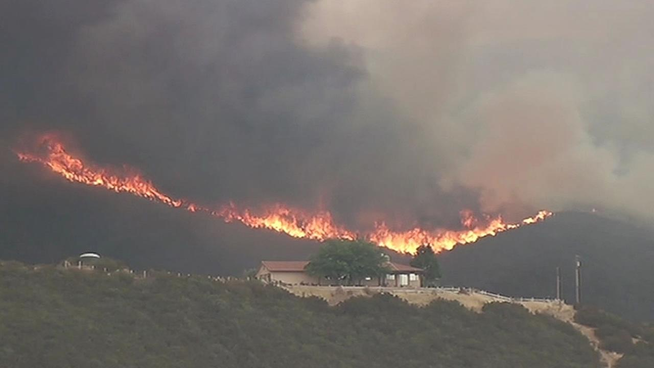 home threatened by wildfire