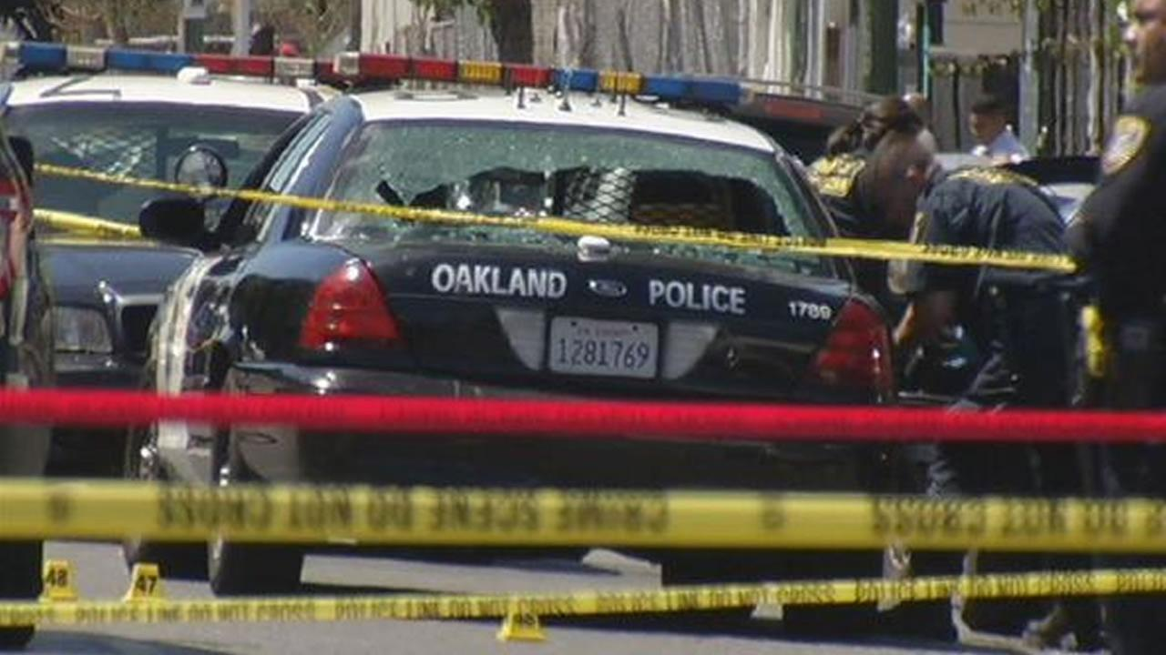 Oakland police investigate the scene of an officer involved shooting that left a suspect dead and one officer injured on Monday, August 3, 2015 in Oakland Calif.