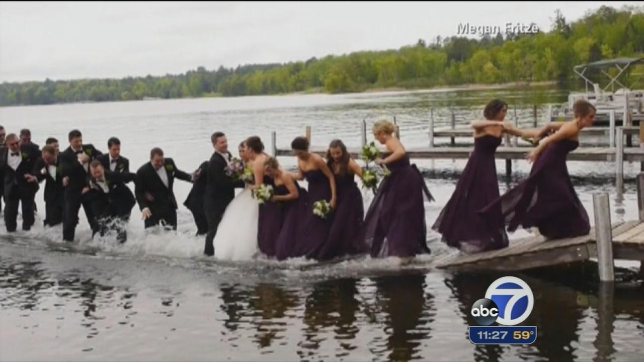 Wedding party falls into lake after dock collapses