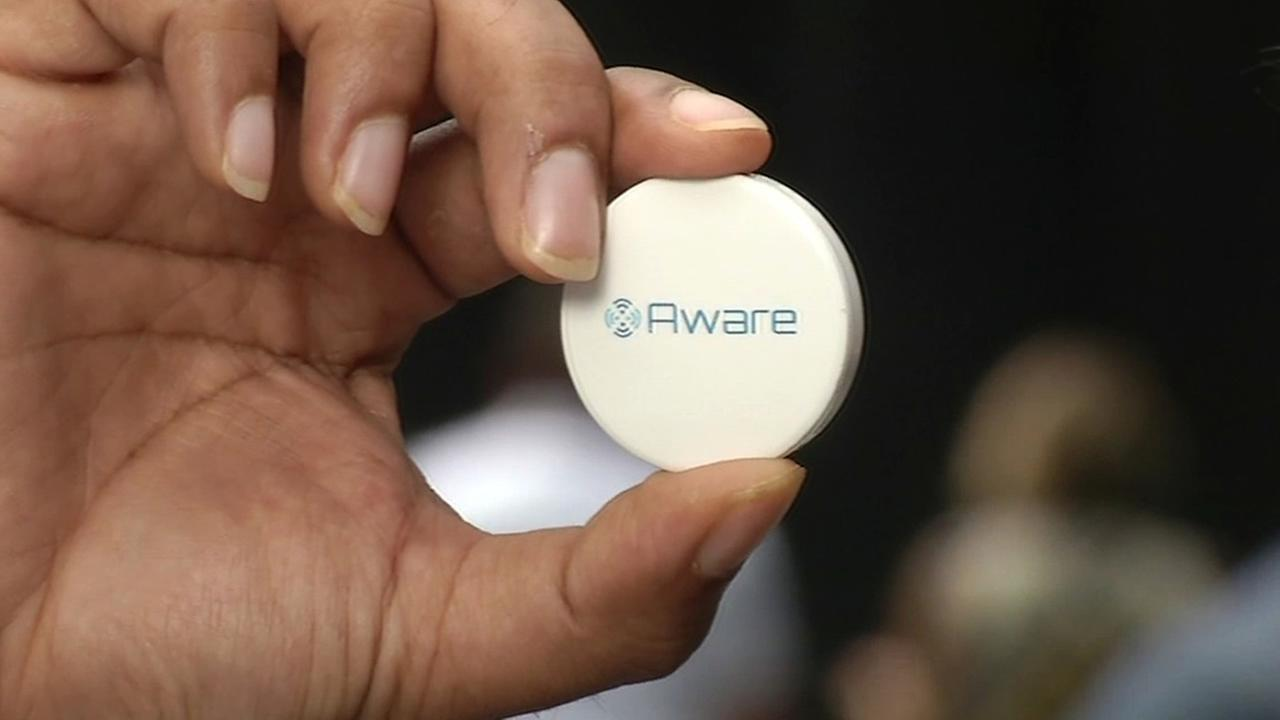 FILE - A new device called Aware Car that helps drivers track down their car is seen in this undated image.