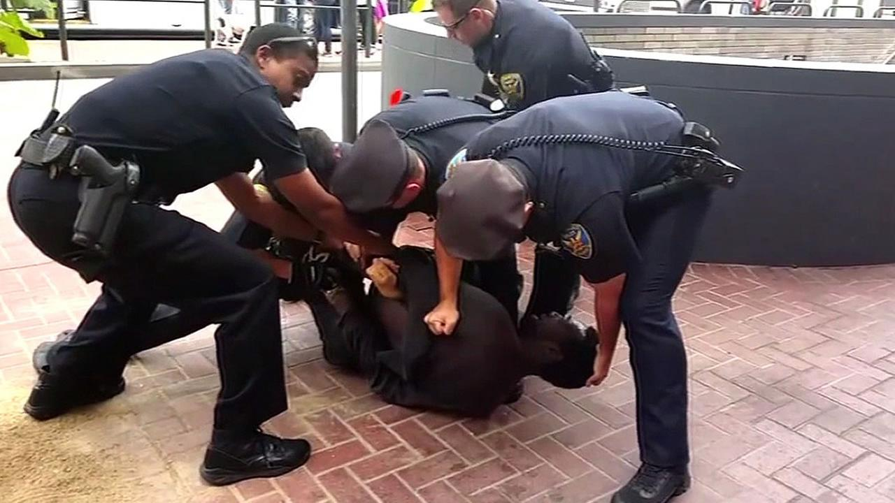 SFPD officers pin Musa Fudge on the ground