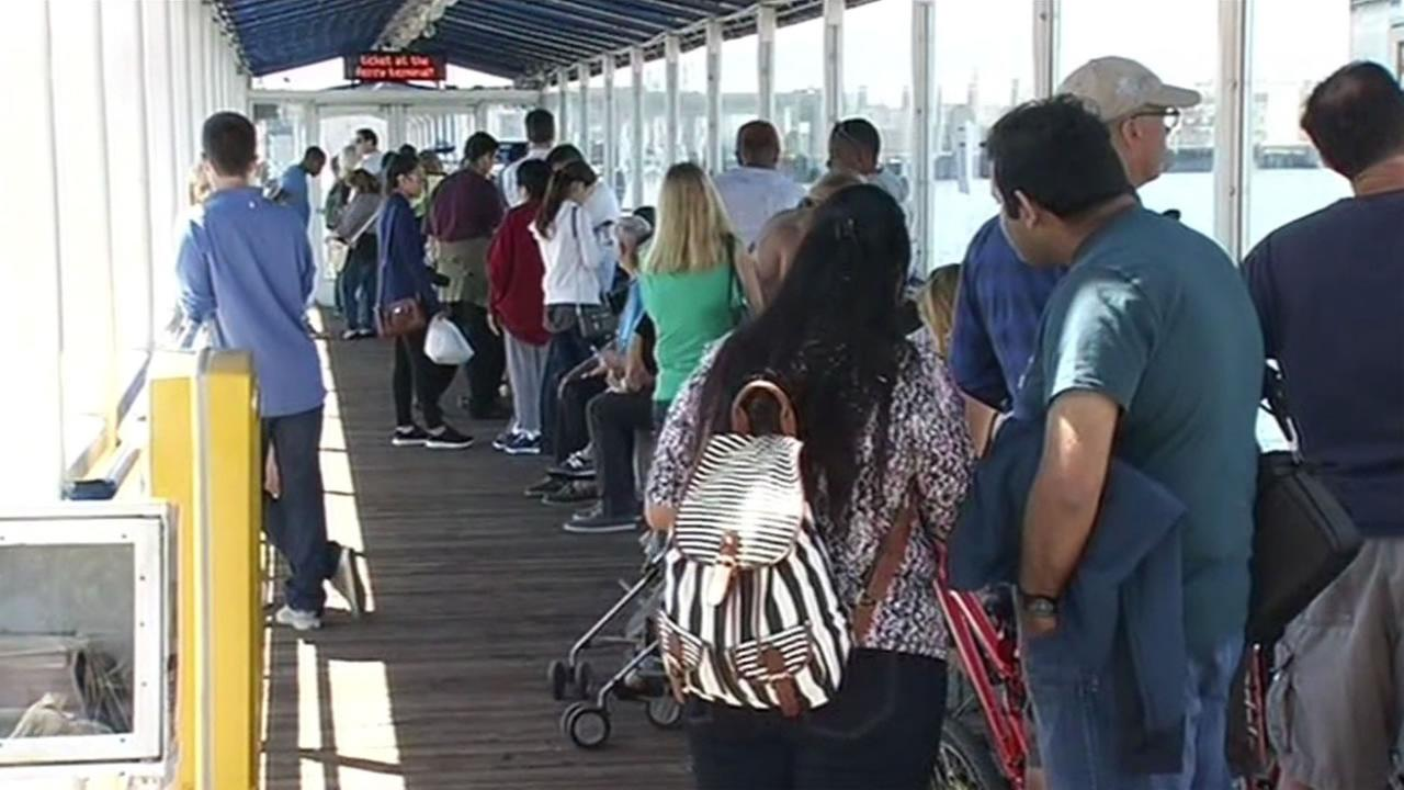 Passengers face long lines for the ferry to cross the San Francisco Bay on Saturday, September 5, 2015.