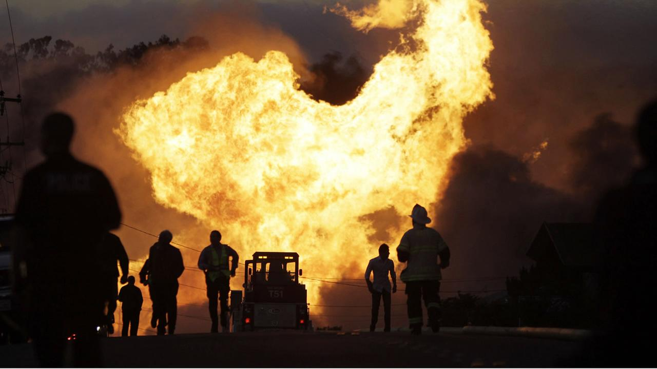 FILE - In this Sept. 9, 2010 file photo, a massive fire roars through a residential neighborhood in San Bruno, Calif. (AP Photo/Paul Sakuma, File)