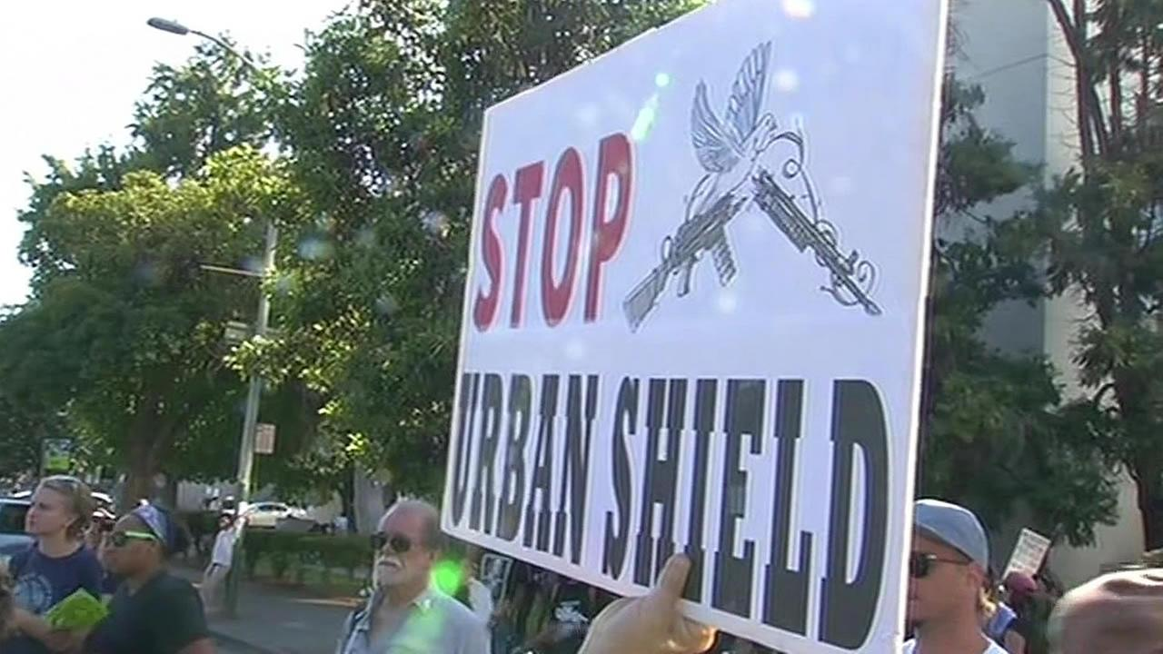 Protest sign reads Stop Urban Shield
