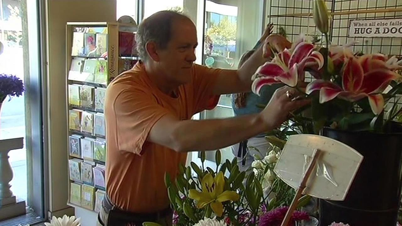 FILE - The owner of Darling Flower Shop in Berkeley is seen arranging flowers in this undated image.