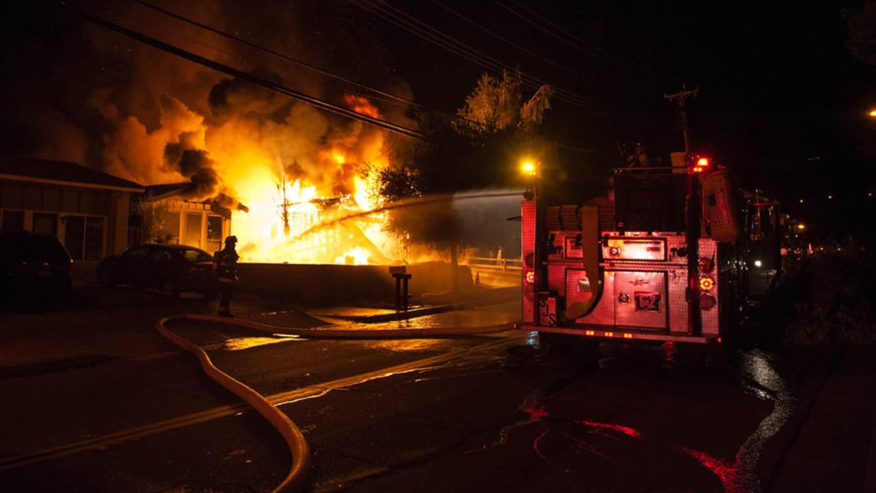 Firefighters battle a 2-alarm house fire on Wednesday, September 16, 2015, in San Jose.