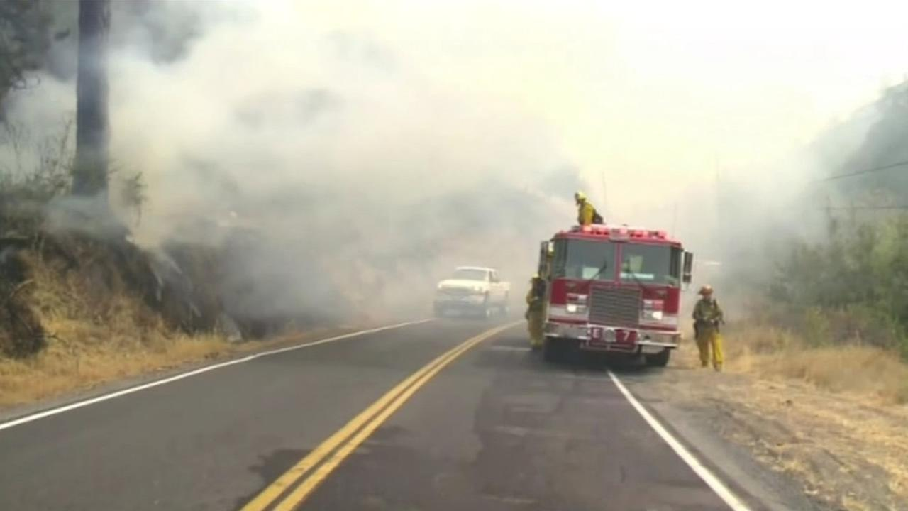FILE - Firefighters are at the scene of the  Butte Fire in this undated image.