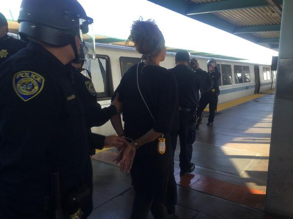 "<div class=""meta image-caption""><div class=""origin-logo origin-image ""><span></span></div><span class=""caption-text"">Arrests being made at West Oakland BART. (@LauraAnthony7) </span></div>"