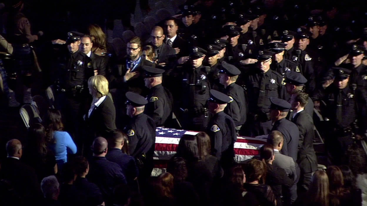 <div class='meta'><div class='origin-logo' data-origin='KGO'></div><span class='caption-text' data-credit=''>San Jose police officers lead the casket of Officer Michael Johnson out of the SAP Center after his memorial service on Thursday, April 2, 2105. (KGO-TV)</span></div>