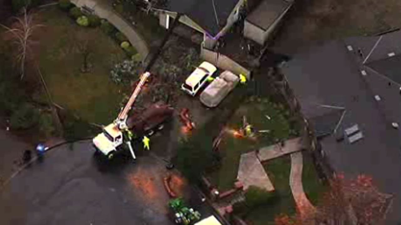 <div class='meta'><div class='origin-logo' data-origin='none'></div><span class='caption-text' data-credit='KGO-TV'>Crews work to repair downed power lines in Berkeley, Calif., on Tuesday, January 19, 2016.</span></div>