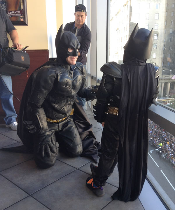 Batman and Batkid look out of the window at Union Square. <span class=meta></span>