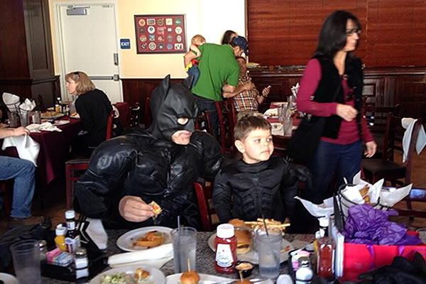 Batkid eating lunch at Burger Bar in San Francisco on November 15, 2013. <span class=meta>KGO</span>