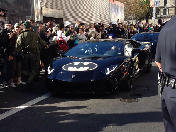Batkid leaves the Bat Cave in the Batmobile to fight crime in