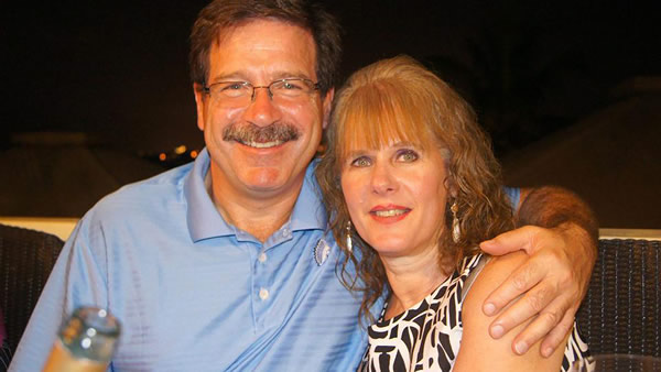 "<div class=""meta ""><span class=""caption-text "">In this undated photo provided by Mark Sherlach, Mark Sherlach and his wife, school psychologist Mary Sherlach, pose for a photo. Mary Sherlach was killed Friday, Dec. 14, 2012, when a gunman opened fire at Sandy Hook Elementary School, in Newtown, Conn., killing 26 children and adults at the school.  (AP Photo/Courtesy of Mark Sherlach)</span></div>"
