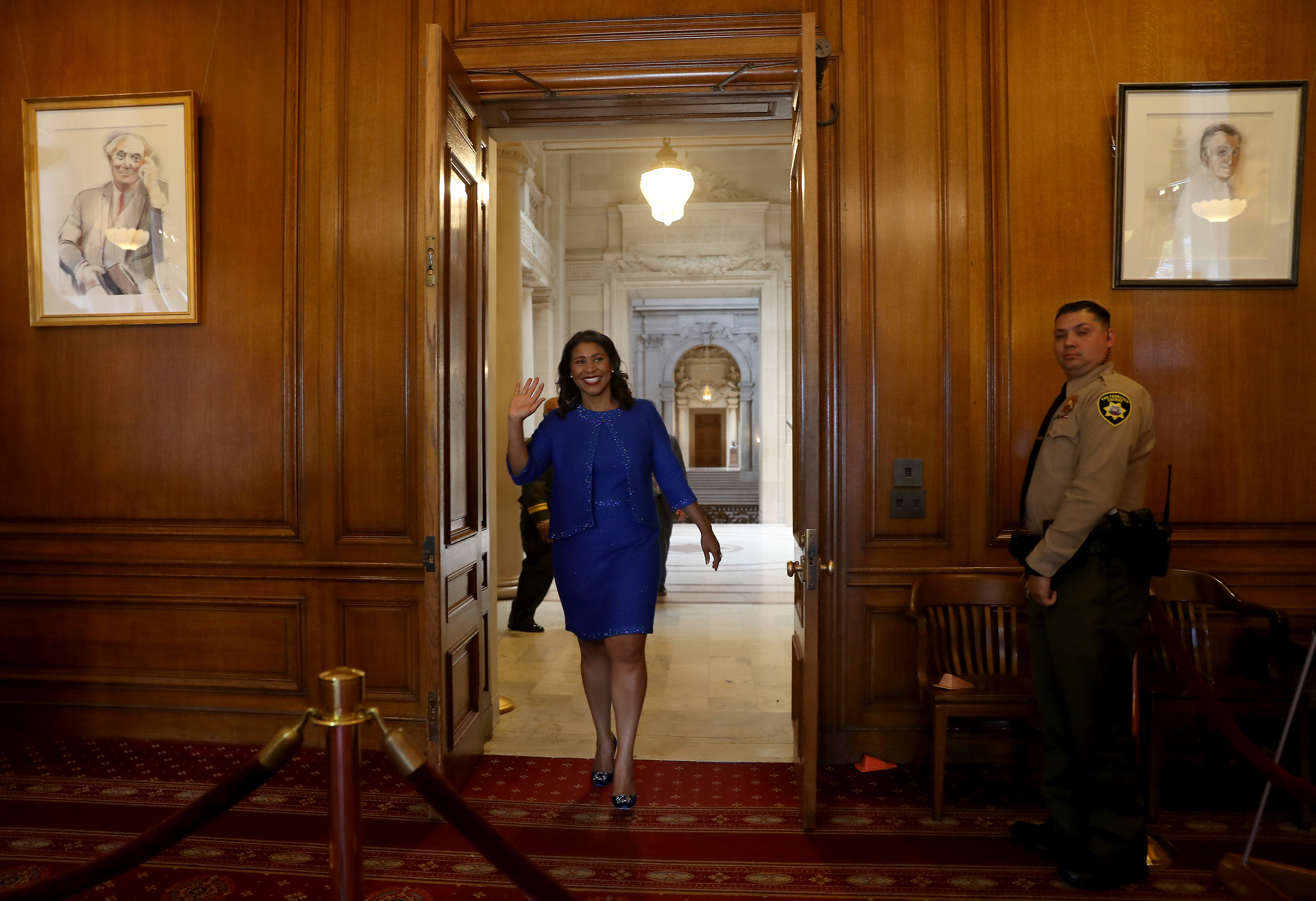 <div class='meta'><div class='origin-logo' data-origin='none'></div><span class='caption-text' data-credit='The Chronicle'>Mayor London Breed walks to her office following her inauguration ceremony on Wednesday, July 11, 2018, in San Francisco.</span></div>