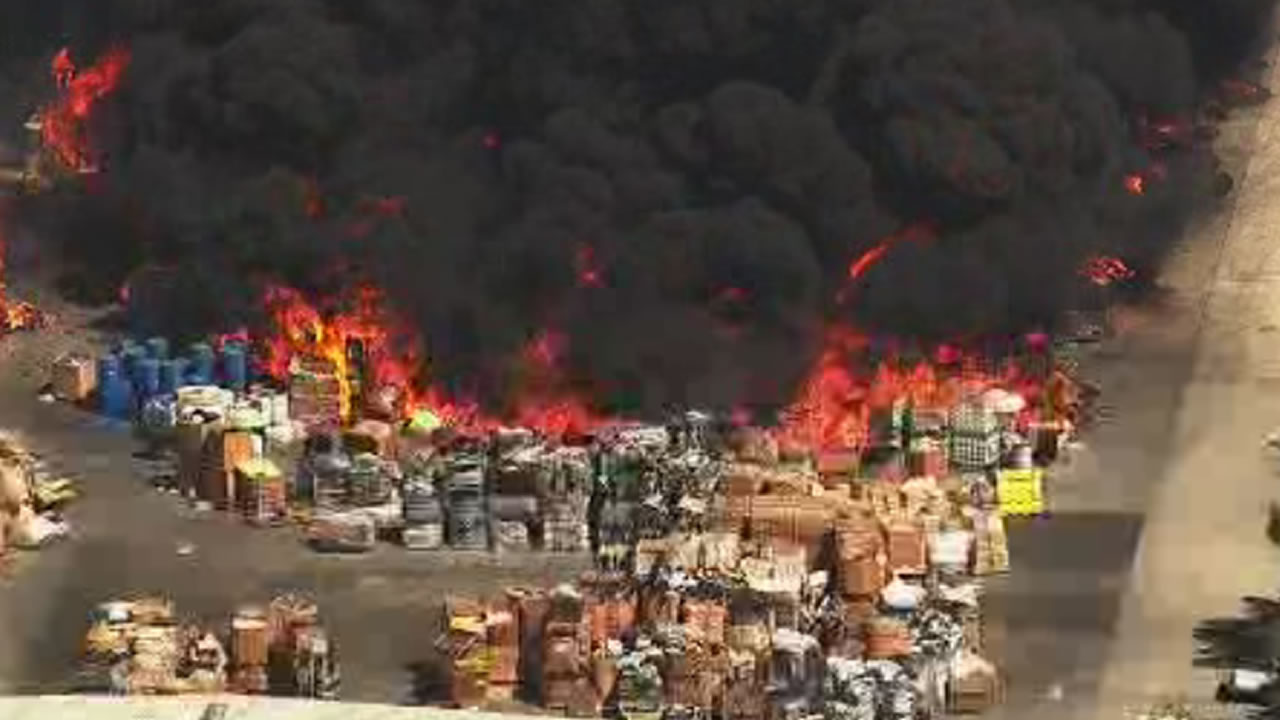 <div class='meta'><div class='origin-logo' data-origin='none'></div><span class='caption-text' data-credit='KGo_TV'>A massive fire burns at a recycling center in Newark, Calif., on Friday, June 8, 2016.</span></div>