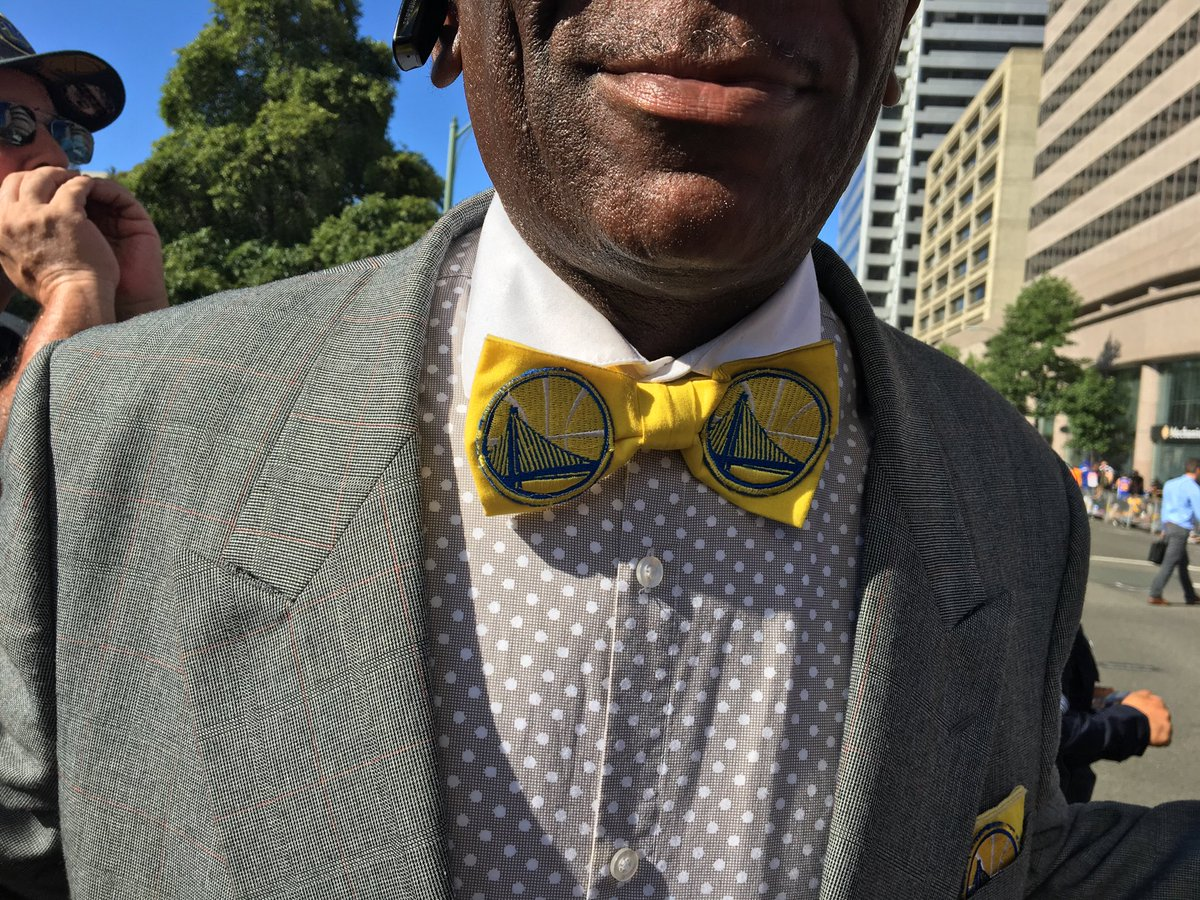 <div class='meta'><div class='origin-logo' data-origin='none'></div><span class='caption-text' data-credit='KGO-TV'>A Warriors fan shows off his bow tie before the victory parade on Tuesday, June 12, 2018 in Oakland, Calif.</span></div>