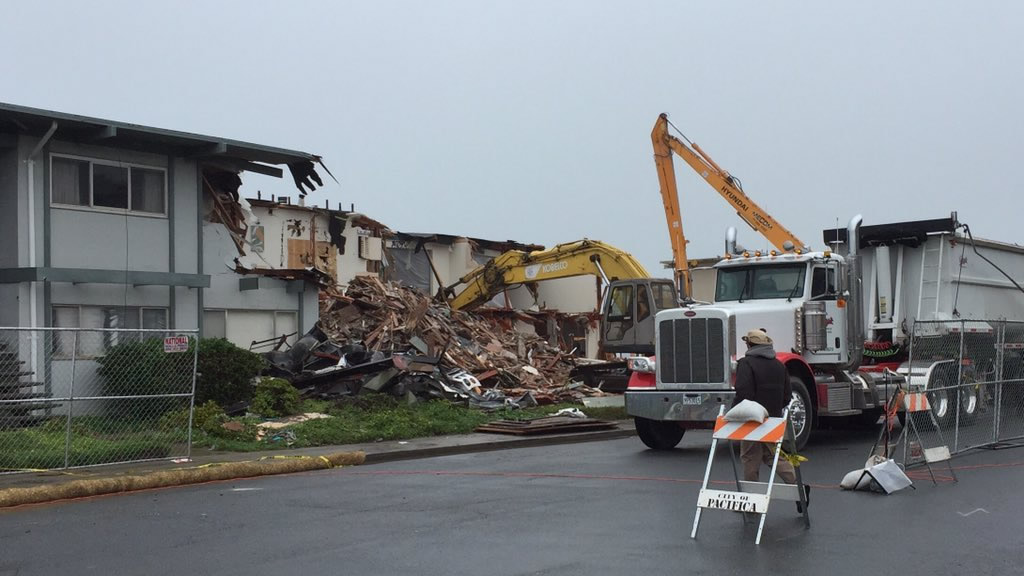 "<div class=""meta image-caption""><div class=""origin-logo origin-image none""><span>none</span></div><span class=""caption-text"">Demolition crews work to tear down a red-tagged apartment along the Pacifica coast on Saturday, March 12, 2016.  (KGO-TV/Sergio Quintana )</span></div>"