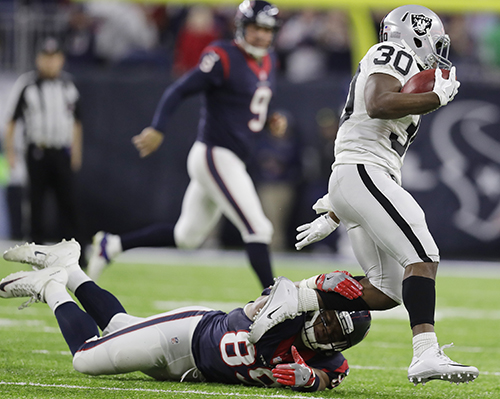 <div class='meta'><div class='origin-logo' data-origin='AP'></div><span class='caption-text' data-credit='AP Photo/Eric Gay'>Oakland Raiders' SaQwan Edwards (30) eludes the tackle of Houston Texans' Stephen Anderson (89) on a punt return during the second half.</span></div>