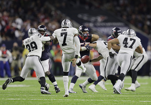 <div class='meta'><div class='origin-logo' data-origin='AP'></div><span class='caption-text' data-credit='AP Photo/Eric Gay'>Oakland Raiders punter Marquette King (7) kicks away against the Houston Texans during the second half of an AFC Wild Card NFL football game Saturday, Jan. 7, 2017, in Houston.</span></div>