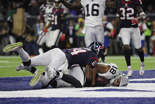 "<div class=""meta image-caption""><div class=""origin-logo origin-image ap""><span>AP</span></div><span class=""caption-text"">Houston Texans cornerback Johnathan Joseph (24) tackles Oakland Raiders wide receiver Andre Holmes (18) after Holmes scored a touchdown. (AP Photo/Eric Gay)</span></div>"