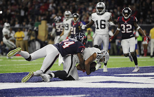 <div class='meta'><div class='origin-logo' data-origin='AP'></div><span class='caption-text' data-credit='AP Photo/Eric Gay'>Houston Texans cornerback Johnathan Joseph (24) tackles Oakland Raiders wide receiver Andre Holmes (18) after Holmes scored a touchdown.</span></div>