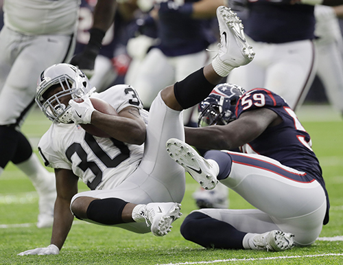 <div class='meta'><div class='origin-logo' data-origin='AP'></div><span class='caption-text' data-credit='AP Photo/Eric Gay'>Houston Texans outside linebacker Whitney Mercilus (59) tackles Oakland Raiders defensive back SaQwan Edwards (30) during the first half.</span></div>