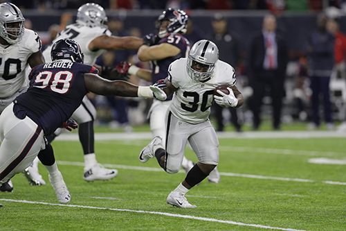 <div class='meta'><div class='origin-logo' data-origin='AP'></div><span class='caption-text' data-credit='AP Photo/Eric Gay'>Oakland Raiders defensive back SaQwan Edwards (30) runs past Houston Texans defensive end D.J. Reader (98) during the second half.</span></div>