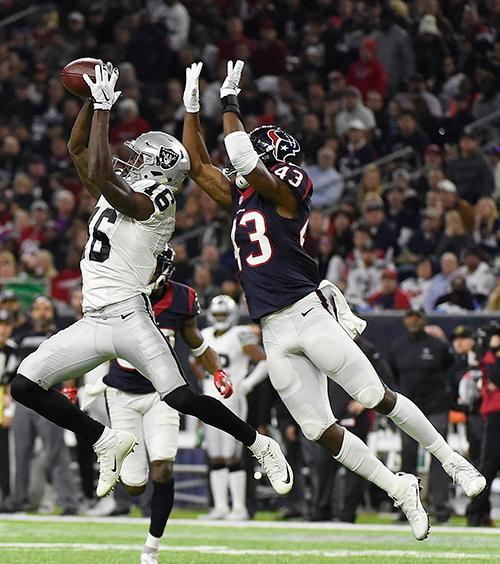 <div class='meta'><div class='origin-logo' data-origin='AP'></div><span class='caption-text' data-credit='AP Photo/Eric Gay'>Oakland Raiders wide receiver Johnny Holton (16) misses the catch against Houston Texans strong safety Corey Moore (43).</span></div>