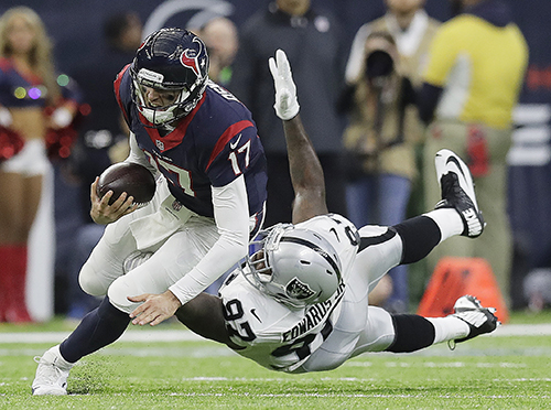 <div class='meta'><div class='origin-logo' data-origin='AP'></div><span class='caption-text' data-credit='AP Photo/Eric Gay'>Houston Texans quarterback Brock Osweiler (17) scrambles for a first down against Oakland Raiders defensive end Mario Edwards (97).</span></div>