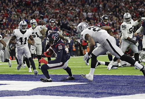 "<div class=""meta image-caption""><div class=""origin-logo origin-image ap""><span>AP</span></div><span class=""caption-text"">Houston Texans wide receiver DeAndre Hopkins (10) makes a touchdown catch against Oakland Raiders cornerback Sean Smith (21). (AP Photo/Eric Gay)</span></div>"