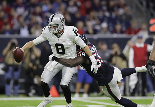 <div class='meta'><div class='origin-logo' data-origin='AP'></div><span class='caption-text' data-credit='AP Photo/Eric Gay'>Oakland Raiders quarterback Connor Cook (8) is sacked by Houston Texans outside linebacker Whitney Mercilus (59).</span></div>