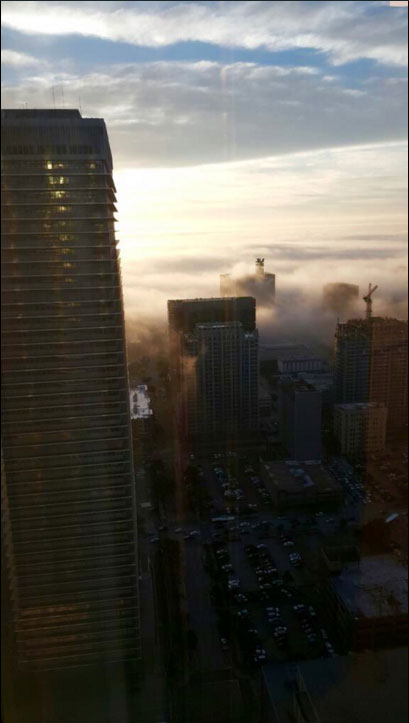 "<div class=""meta image-caption""><div class=""origin-logo origin-image none""><span>none</span></div><span class=""caption-text"">abc13 reporter Courtney Fischer's husband snapped this shot of the dense fog in Downtown Houston.</span></div>"