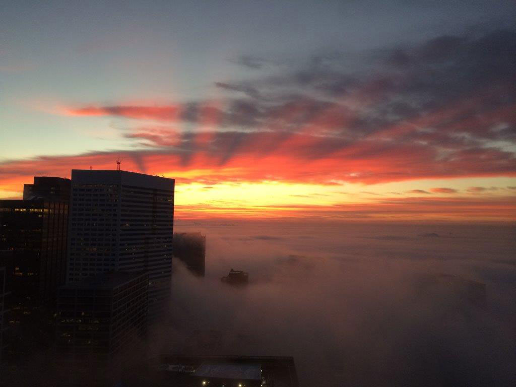 "<div class=""meta image-caption""><div class=""origin-logo origin-image none""><span>none</span></div><span class=""caption-text"">A breathtaking shot of the sunrise over our fog-covered city of Houston. (Photo Credit: M. Monica Rodriguez)</span></div>"
