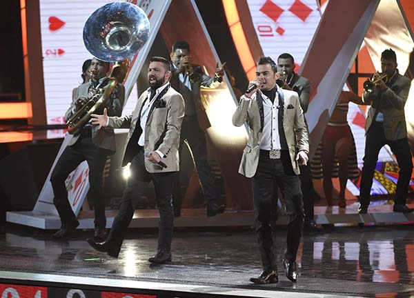 <div class='meta'><div class='origin-logo' data-origin='AP'></div><span class='caption-text' data-credit='Chris Pizzello/Invision/AP'>Alfonso Lizarraga, left, and Joel Lizarraga, of Banda el Recodo, perform a medley at the 16th annual Latin Grammy Awards</span></div>
