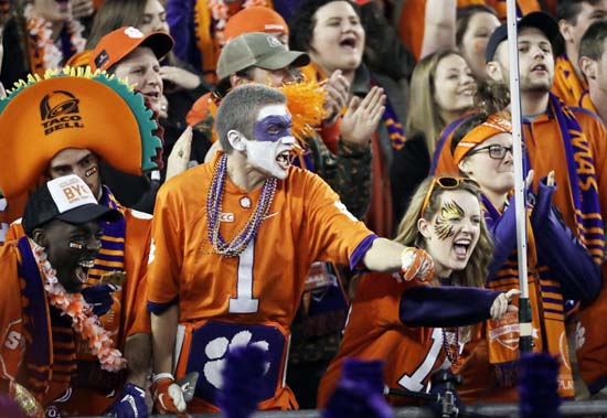 "<div class=""meta image-caption""><div class=""origin-logo origin-image ap""><span>AP</span></div><span class=""caption-text"">Clemson fans cheer before the NCAA college football playoff championship game against Alabama Monday, Jan. 9, 2017, in Tampa, Fla. (AP Photo/David J. Phillip) (AP)</span></div>"