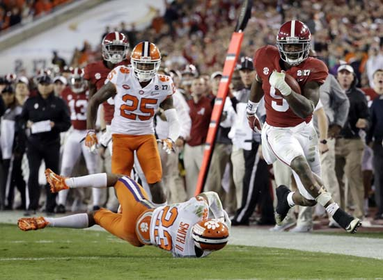 "<div class=""meta image-caption""><div class=""origin-logo origin-image ap""><span>AP</span></div><span class=""caption-text"">Alabama's Bo Scarbrough runs for a touchdown during the first half of the NCAA college football playoff championship game against Clemson. (AP Photo/David J. Phillip) (AP)</span></div>"