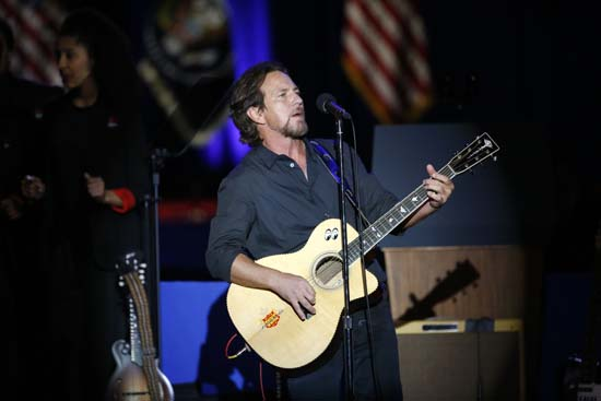 <div class='meta'><div class='origin-logo' data-origin='AP'></div><span class='caption-text' data-credit='AP'>Singer Eddie Vedder performs before President Barack Obama gives his presidential farewell address at McCormick Place in Chicago. (AP Photo/Charles Rex Arbogast)</span></div>