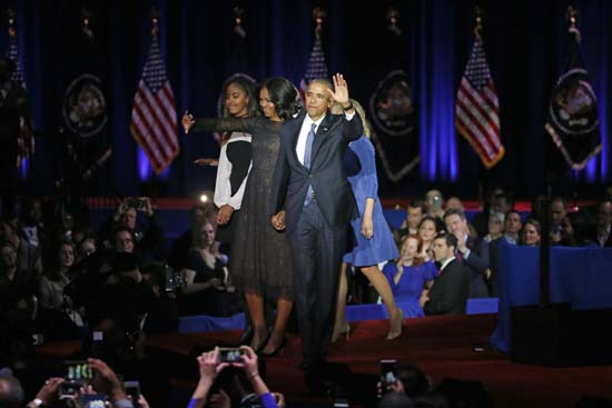 <div class='meta'><div class='origin-logo' data-origin='AP'></div><span class='caption-text' data-credit='AP'>President Barack Obama waves as he is joined by First Lady Michelle Obama, his daughter Malia Obama, Vice President Joe Biden and Dr. Jill Biden. (AP Photo/Charles Rex Arbogast)</span></div>