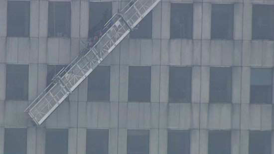 "<div class=""meta image-caption""><div class=""origin-logo origin-image none""><span>none</span></div><span class=""caption-text"">Two workers were rescued from outside a 75-story building in downtown Houston (KTRK Photo)</span></div>"
