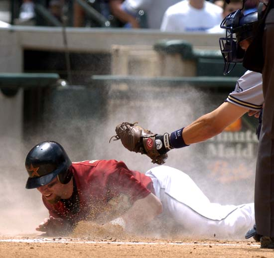 <div class='meta'><div class='origin-logo' data-origin='AP'></div><span class='caption-text' data-credit='Brett Coomer)'>Houston Astros' Jeff Bagwell slides past the tag of Milwaukee Brewers catcher Chad Moeller to score in a Jeff Kent double during the third inning Sunday, April 18, 2004 in Houston.</span></div>