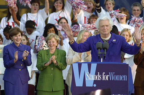 <div class='meta'><div class='origin-logo' data-origin='AP'></div><span class='caption-text' data-credit='AP Photo/Paul Warner'>Former first lady Barbara Bush, right, quiets the crowd before speaking at a rally Wednesday, Oct. 18, 2000, in Southfield, Mich.</span></div>