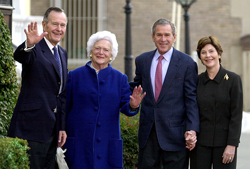 <div class='meta'><div class='origin-logo' data-origin='AP'></div><span class='caption-text' data-credit='AP Photo/Susan Walsh'>President Bush and first lady Laura Bush, right, walk with former President George H. W. Bush and former first lady Barbara Bush after attending Sunday service.</span></div>