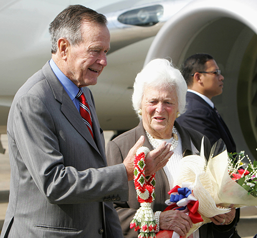 <div class='meta'><div class='origin-logo' data-origin='AP'></div><span class='caption-text' data-credit='AP Photo/Pornchai Kittiwongsakul, Pool'>Former U.S. President George Bush holds a garland next to his wife Barbara upon arrival at military airport in Bangkok Sunday, Dec. 10, 2006.</span></div>