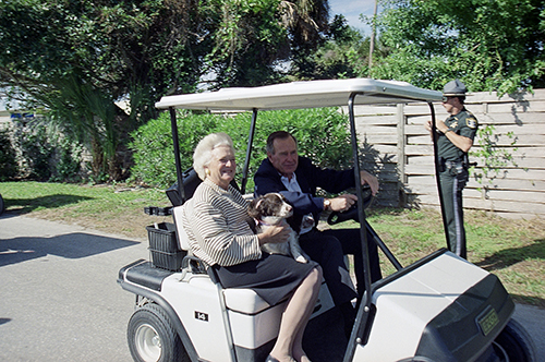 <div class='meta'><div class='origin-logo' data-origin='AP'></div><span class='caption-text' data-credit='AP Photo/Lynne Sladky'>U. S. President George H. Bush, his wife Barbara, and their dogs ride a golf cart to their waiting helicopter as they leave Boca Grande, Fla., Sunday, Nov. 15, 1992.</span></div>
