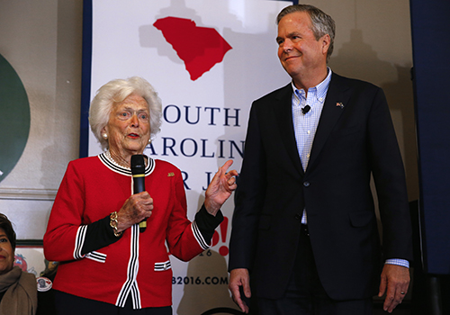<div class='meta'><div class='origin-logo' data-origin='AP'></div><span class='caption-text' data-credit='AP Photo/Paul Sancya'>Republican presidential candidate, former Florida Gov. Jeb Bush, listens as his mother, former first lady Barbara speak during a 2016 campaign stop.</span></div>
