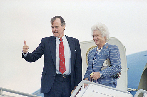 <div class='meta'><div class='origin-logo' data-origin='AP'></div><span class='caption-text' data-credit='AP Photo/J. Scott Applewhite'>President-elect George H.W. Bush, left, and his wife Barbara Bush wave goodbye from the steps of Air Force Two in West Palm Beach, Fla., in 1998.</span></div>