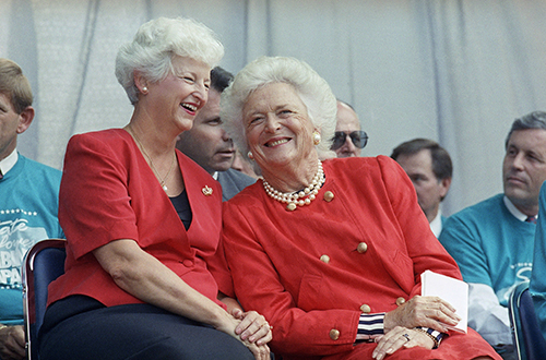 <div class='meta'><div class='origin-logo' data-origin='AP'></div><span class='caption-text' data-credit='AP Photo/Brad Isbell'>First Lady Barbara Bush, right, nudges Dottie Martin, wife of North Carolina Gov. Jim Martin, as the two share a laugh, Wednesday, Sept. 2, 1992, Raleigh, N.C.</span></div>