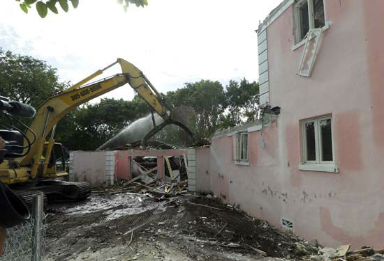 <div class='meta'><div class='origin-logo' data-origin='none'></div><span class='caption-text' data-credit='AP Photo/ Lynne Sladky'>A bulldozer demolishes the waterfront mansion formerly owned by Colombian drug lord Pablo Escobar in Miami Beach, Florida</span></div>