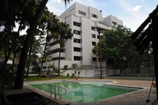 <div class='meta'><div class='origin-logo' data-origin='none'></div><span class='caption-text' data-credit='AP Photo/ Luis Benavides'>Escobar owned other properties including this Monaco building that was seized by the National Drug Office, in Medellin Colombia.</span></div>